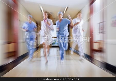 Surgeon and nurse running stock photo, Surgeon and nurse running in hallway of hospital by Tyler Olson
