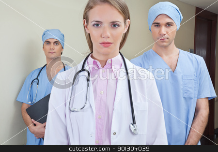 Team of confident young doctor stock photo, Team of confident young doctor in hospital by Tyler Olson