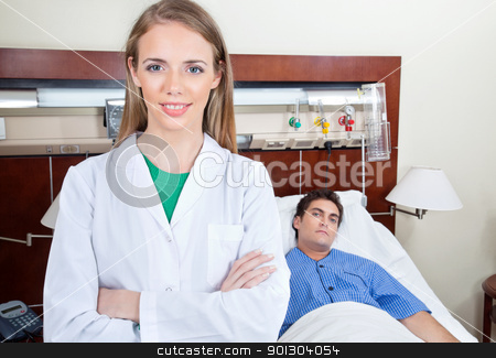 Confident female doctor stock photo, Confident female doctor with patient in hospital by Tyler Olson