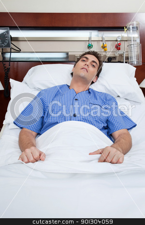 An severe male patient stock photo, An severe male patient at hospital bed by Tyler Olson