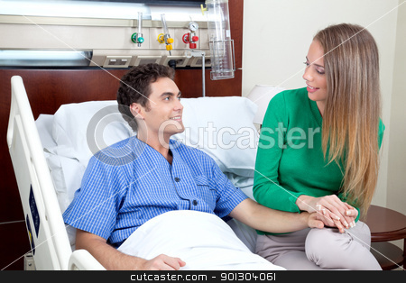 Young couple looking at each other stock photo, Young couple looking at each other in hospital by Tyler Olson