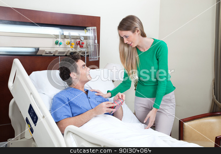 Woman paying a visit to the patient stock photo, Young woman paying a visit to the patient in hospital by Tyler Olson