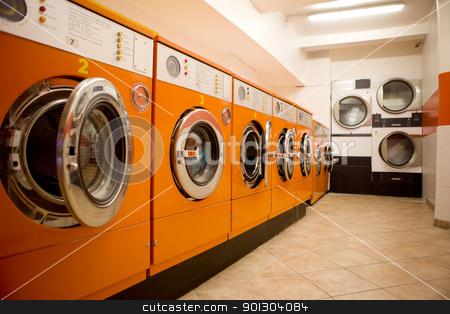 Laundromat stock photo, An interior of a retro looking laundromat by Tyler Olson