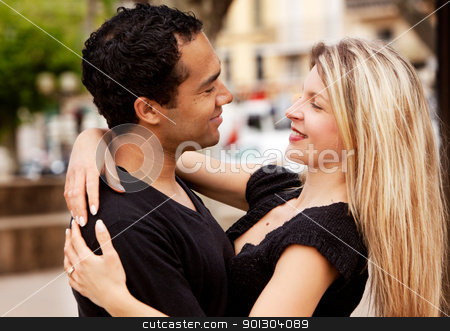 Happy European Couple stock photo, A happy couple holding and looking at eachother. by Tyler Olson