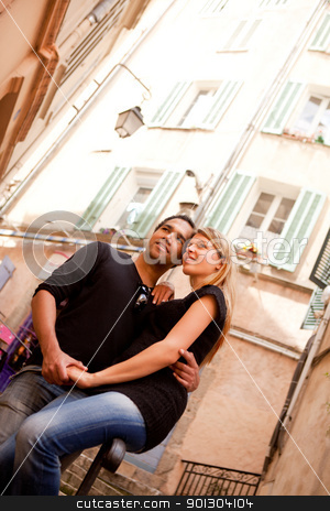 French Lifestyle Couple stock photo, A happy french couple in a small quaint street by Tyler Olson