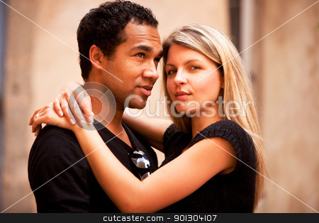 Attractive French Couple  stock photo, An attractive french couple in an outdoor urban setting by Tyler Olson