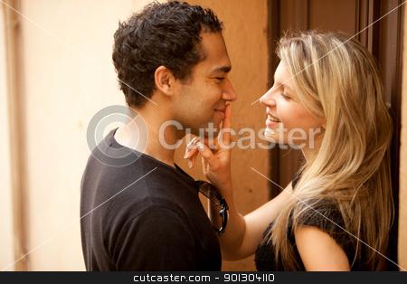 Couple Flirt Kiss stock photo, A couple flirting on a quaint street in France, Europe by Tyler Olson