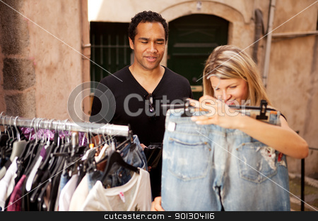 Epensive Clothes Shopping stock photo, A woman shopping for expensive clothes, shallow depth of field - focus on man by Tyler Olson