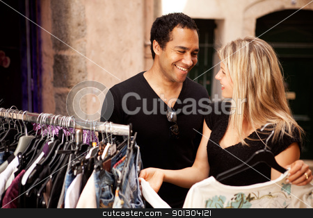 Shopping Couple Happy stock photo, A happy couple shopping at a small street store in Europe by Tyler Olson