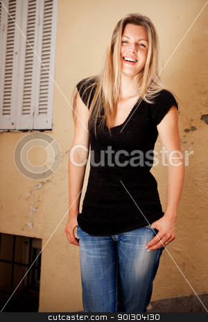 Beautiful Casual Woman  stock photo, A casual portrait of a happy friendly woman on a quaint european street by Tyler Olson