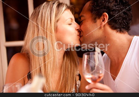 Romantic Cafe Restaurant stock photo, A couple having a romatic meal in an outdoor restaurant by Tyler Olson