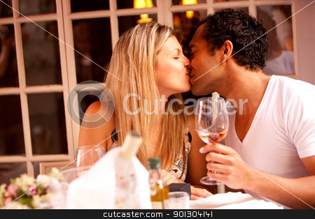 Romantic Meal stock photo, A man and woman having a romantic meal in an outdoor cafe by Tyler Olson