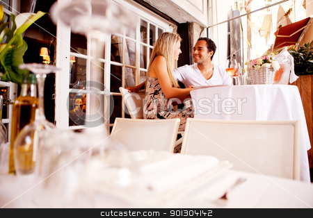 Couple in Outdoor Restaurant stock photo, A happy couple on a date in an outdoor restaurant  by Tyler Olson