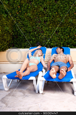 Couple Pool Side stock photo, A couple relaxing at a hotel pool by Tyler Olson