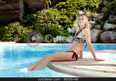 Bikini Pool Woman stock photo, A woman relaxing at a hotel pool by Tyler Olson