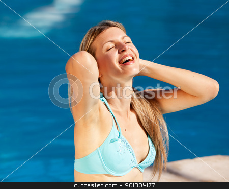 Woman Pool Relax stock photo, A caucasian blond woman relaxing at an outdoor pool by Tyler Olson