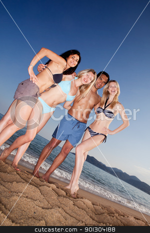 Happy Friends on Beach stock photo, A group of friends having fun on the beach by Tyler Olson