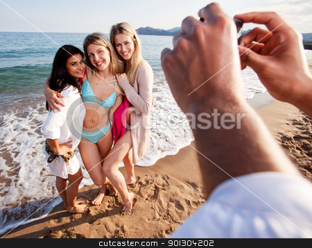 Camera Phone Beach Potrait stock photo, A group of women having their picture taken by a camera phone.  Shallow depth of field, focus on women. by Tyler Olson
