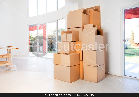 Moving Boxes stock photo, A stack of moving boxes in a new house, ready to unpack by Tyler Olson