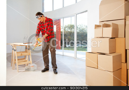 Carpenter stock photo, A finishing carpenter cutting wood in a house by Tyler Olson