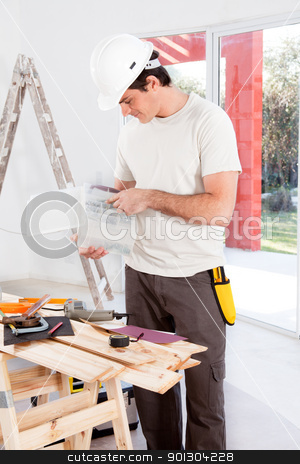 Home Improvement stock photo, A man looking for a screw, doing home improvements by Tyler Olson