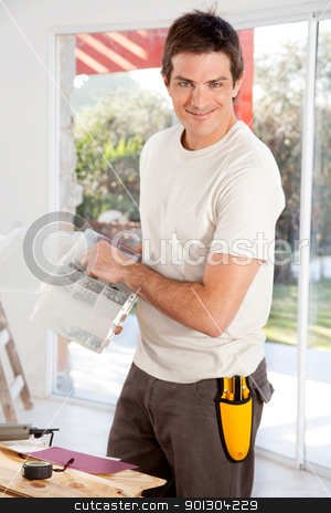 Home Improvement Man stock photo, A man doing home improvements in a house by Tyler Olson