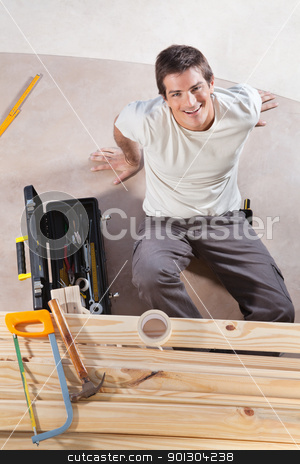 Construction Worker stock photo, A construction worker with tools and wood by Tyler Olson