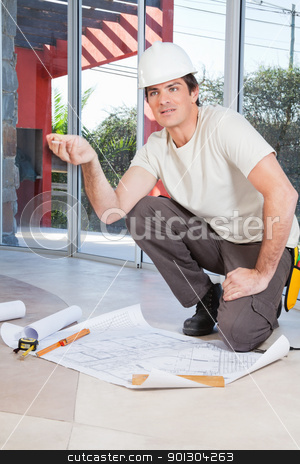 Construction worker with project paper stock photo, Construction worker concerned about the project by Tyler Olson