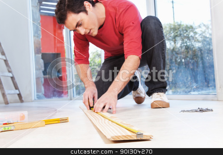Architect measuring the plank stock photo, Architect measuring the wooden plank with measuring tape by Tyler Olson