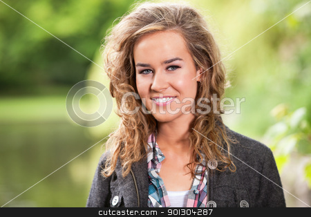 Happy blond female smiling stock photo, Close-up portrait of happy young blond woman by Tyler Olson