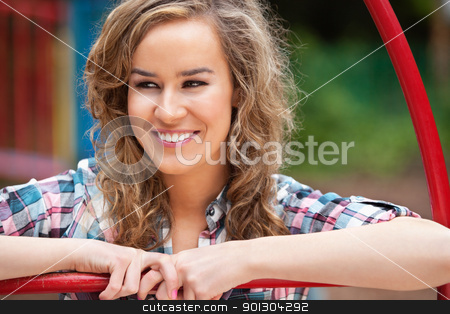 Happy young female looking away stock photo, Happy young female looking away and smiling outdoors by Tyler Olson