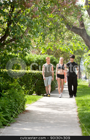 People taking morning walk stock photo, Morning walk of three friends in a park by Tyler Olson