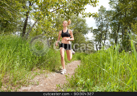 woman jogging in a park stock photo, Woman in sportswear running in a park by Tyler Olson