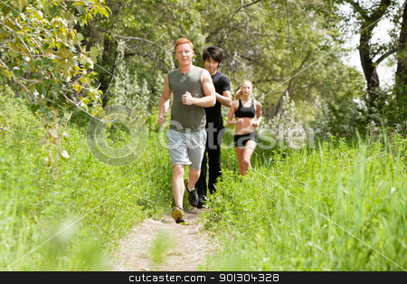 Friends jogging in the forest stock photo, Group of healthy friends jogging in the forest by Tyler Olson
