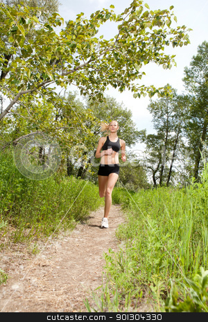 Beautiful woman jogging stock photo, Young woman jogging outdoors in summer on trail by Tyler Olson