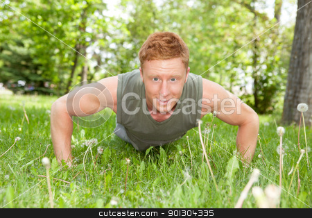 Portrait of man doing a push up stock photo, An attractive Caucasian man doing a push up outdoors by Tyler Olson