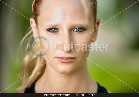 Close-up portrait of a young woman stock photo, Close-up portrait of young serious woman against blur background by Tyler Olson