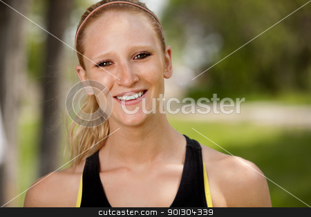Jogger Portrait stock photo, A portrait of a happy female jogger smiling at the camera by Tyler Olson