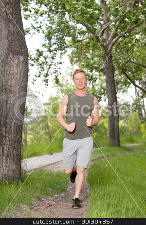 Portrait of a man running stock photo, Portrait of a young man running in a park by Tyler Olson