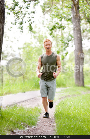 Young man jogging stock photo, Man jogging during morning time in a park by Tyler Olson