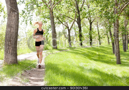 Portrait of woman jogging stock photo, Portrait of a young beautiful smiling woman jogging by Tyler Olson