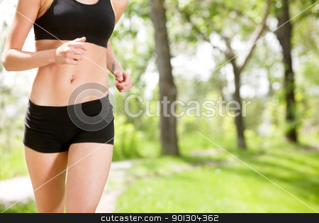 Mid section of a woman stock photo, Mid section of a woman against blur background by Tyler Olson