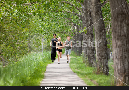 Friends jogging stock photo, Young people running on walkway by trees by Tyler Olson