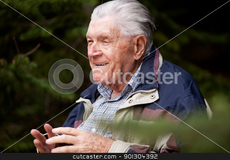 Grandfather Portrait stock photo, A grandfather telling a story in the forest by Tyler Olson