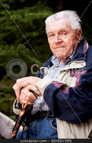 Grandfather stock photo, A portrait of an elderly man sitting looking at the camera by Tyler Olson