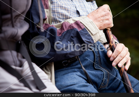 Elderly Man Detail stock photo, Detail of an elderly man with walking stick by Tyler Olson