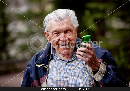 Old Man with Cell Phone stock photo, An old man laughing and smiling with a cell phone. by Tyler Olson