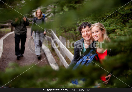 Forest Trail Couple stock photo, A happy couple on a forest trail by Tyler Olson