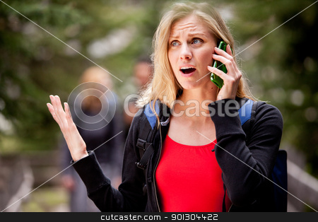 Late Meet Phone stock photo, A woman talking on the phone, frustrated with the person she is talking to by Tyler Olson