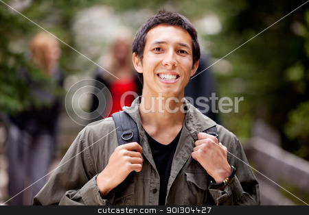 Happy Camper Man stock photo, A happy camper smiling at the camera with a backpack outdoors by Tyler Olson